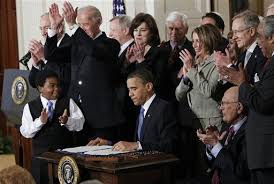 President Obama signs the Affordable Care Act